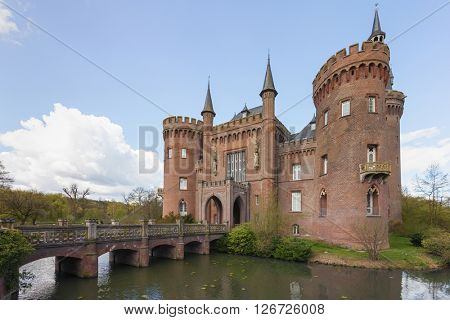 Bedburg-Hau, Germany - April 17, 2016: South-eastern view of Moyland castle in the district of Kleve, one of the most important neo-Gothic buildings in North Rhine-Westphalia