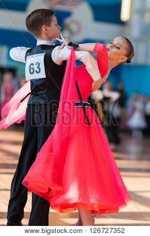 Minsk Belarus -April 3 2016: Novikov Yaroslav and Murza Alina Perform Juvenile-1 Standard Program on the IDSA Championship Kinezis Star Cup in April 3 2016 in Minsk Republic of Belarus