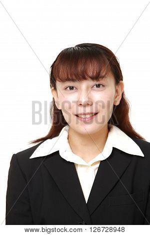 studio shot of Asian businesswoman pleased on white background