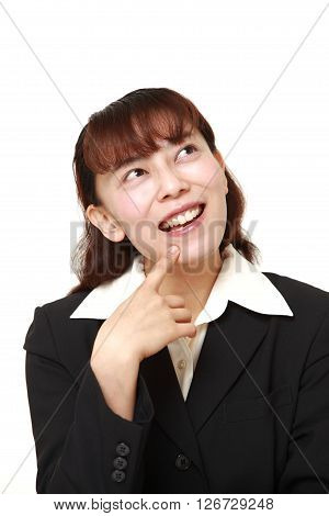 Asian businesswoman dreaming at her future on white background
