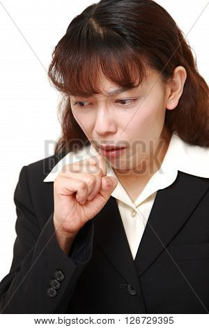 studio shot of Asian businesswoman coughing on white background