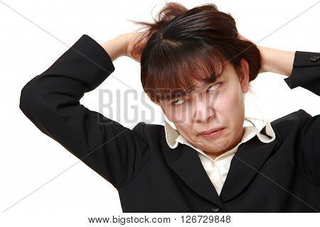 studio shot of demented businesswoman on white background