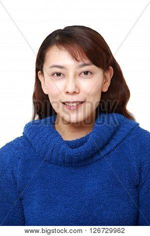 studio shot of Asian woman smiles on white background