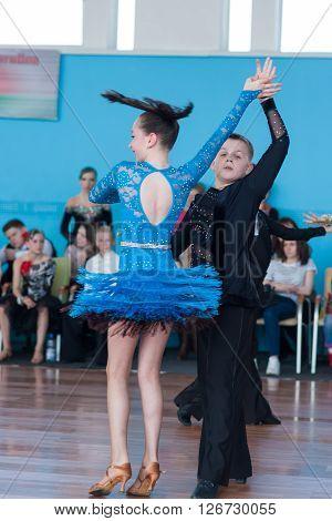 Minsk Belarus -April 3 2016: Babaev Daniel and Butkevich Polina Perform Juvenile-1 Latin-American Program on the IDSA Championship Kinezis Star Cup - 2016 in April 3 2016 in Minsk Republic of Belarus