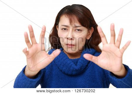 studio shot of Asian woman with supernatural power on white background