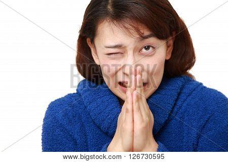 studio shot of woman folding her hands in prayer
