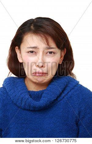 studio shot of sad woman on white background