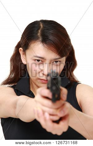 studio shot of a woman with a handgun on white background