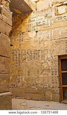 The wall in Khonsu Temple decorated with the reliefs depicting the God of Moon Khons Karnak Complex Luxor Egypt.