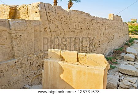 LUXOR EGYPT - OCTOBER 7 2014: The giant walls of Karnak Temple were covered by reliefs with hieroglyphs and pictures  on October 7 in Luxor.