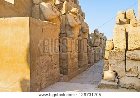 LUXOR EGYPT - OCTOBER 7 2014: The row of the ruined statues in Karnak Temple on October 7 in Luxor.