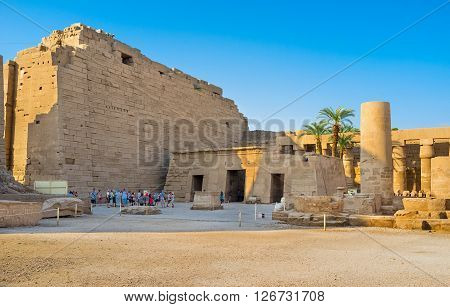 LUXOR EGYPT - OCTOBER 7 2014: The courtyard of the Karnak Temple contains many interesting objects such as rows of sphinxes giant columns and pharaohs' statues on October 7 in Luxor.