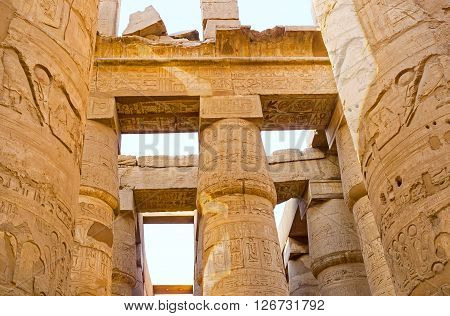 The numerous columns of the Hypostyle Hall are fine examples of the ancient Egyptian art Karnak Temple Luxor Egypt.