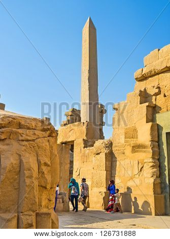 LUXOR EGYPT - OCTOBER 7 2014: The walk through the maze of the ancient ruins in the Karnak Temple complex on October 7 in Luxor.