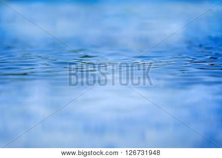 Shallow focus looking across blue water with ripples