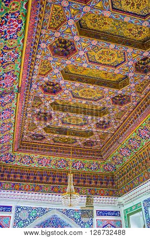 KOKAND UZBEKISTAN - MAY 6 2015: The ceiling in the Great Throne Room of Khudayar Khan Palace decorated in brown color gamma with fine patterns on May 6 in Kokand.