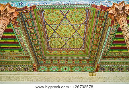 KOKAND UZBEKISTAN - MAY 6 2015: The wooden screen on the ceiling of Jami Mosque with the stellar and floral patterns on May 6 in Kokand.