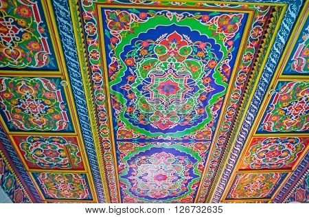 KOKAND UZBEKISTAN - MAY 6 2015: The ceiling in the Khudayar Khan Palace covered with the colorful paintings on May 6 in Kokand.