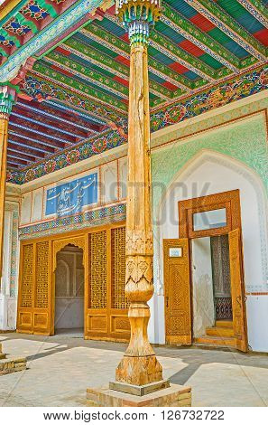 KOKAND UZBEKISTAN - MAY 6 2015: The carved wooden door leads from the courtyard to the Throne rooms of Khudayar Khan Palace on May 6 in Kokand.