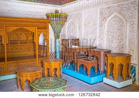 KOKAND UZBEKISTAN - MAY 6 2015: The examples of the traditional Uzbek wooden carved furniture in room of Khudayar Khan Palace on May 6 in Kokand.
