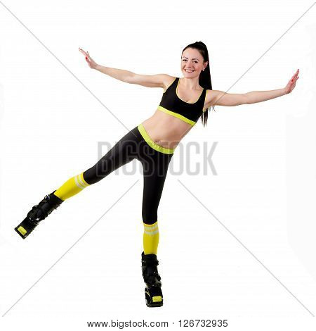 Smiling brunette girl with long hair in a black sportswear training in a kangoo jumps shoes. isolated on a white background.