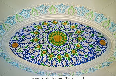 KOKAND UZBEKISTAN - MAY 6 2015: The ellipse decoration on the plaster ceiling with in Museum of Jami Mosque on May 6 in Kokand.