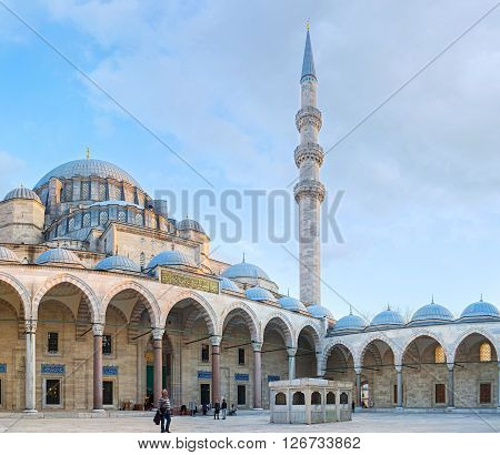 ISTANBUL TURKEY - JANUARY 21 2015: The courtyard of the Suleymaniye Mosque with the view on the main entrance and the ablution fountain located in the middle on January 21 in Istanbul.