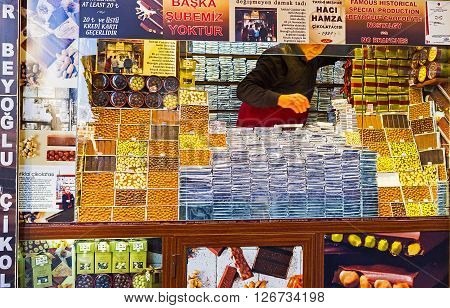 ISTANBUL TURKEY - JANUARY 22 2015: The kiosk offers wide range of chocolate bars and candies of nuts covered with chocolate Independence Avenue on January 22 in Istanbul.