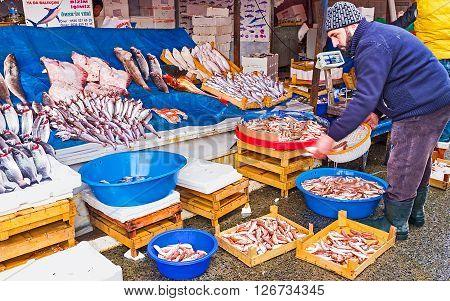 ISTANBUL TURKEY - JANUARY 21 2015: The central fish market next to Galata bridge is open from the early morning to the dusk on January 21 in Istanbul.