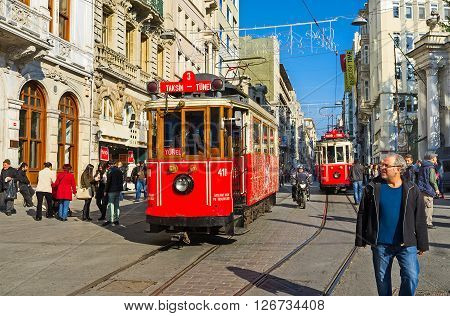 ISTANBUL TURKEY - JANUARY 22 2015: The red retro trams in Independence Avenue departed in different directions: one - to the Taksim Square another - to the Tunel on January 22 in Istanbul.