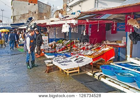 ISTANBUL TURKEY - JANUARY 21 2015: The central fish market next to Galata bridge is the best place to choose the fresh fish or seafood on each taste on January 21 in Istanbul.