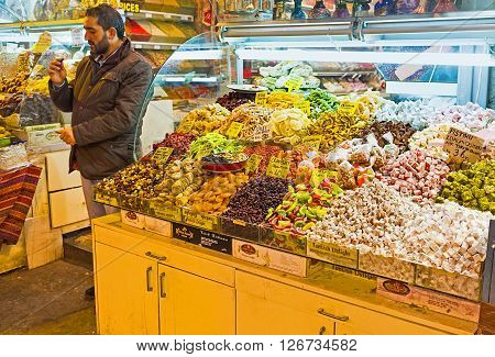 ISTANBUL TURKEY - JANUARY 21 2015: The market stall offering Turkish delight and dried fruits on January 21 in Istanbul.