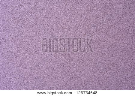 New clean violet plaster wall for background or texture