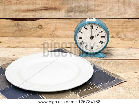 Meal time table place setting with alarm clock