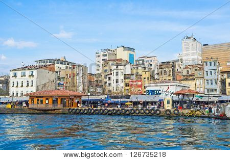 ISTANBUL TURKEY - JANUARY 21 2015: The central fish market has its own haven for the fishing boats that adjacent to the ferry terminal on January 21 in Istanbul.
