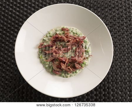 Smoked ham hock, parsley sauce, broad beans & peas
