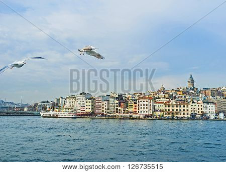 The view on promenade of the Beyoglu district topped by medieval Galata Tower Istanbul Turkey. ** Note: Visible grain at 100%, best at smaller sizes