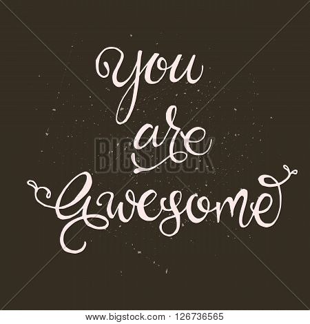 Handwritten vector lettering phrase You are awesome. Brush lettering calligraphy style writing. Whimsical letters on dark chalkboard looking scratched textured surface. Perfect for t-shirt design
