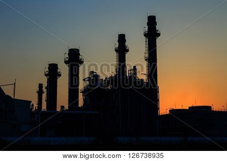 Gas turbine electrical power plant after sunset at dusk