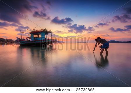 Long boat with beautiful sunrise seascape, beach in Phuket, Thailand.