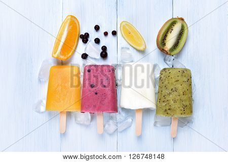 Homemade frozen ice cream popsicles from fruits top view