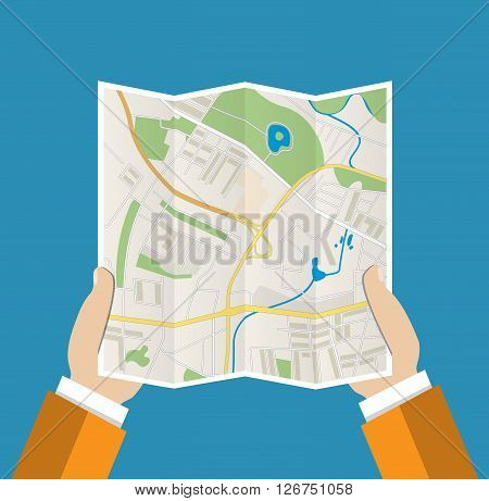 Folded Paper Map In Hand, Abstract generic city map with roads, buildings, parks, river. Vector Illustration in flat design on blue background