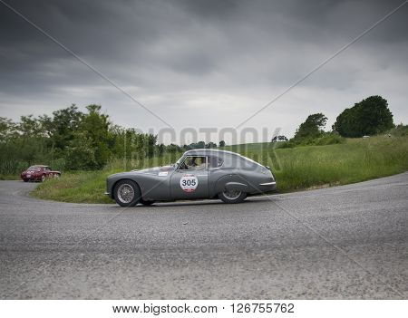 PESARO, ITALY - MAY 15: FIAT 8V berlinetta 1954 on an old racing car in rally Mille Miglia 2015 the famous italian historical race (1927-1957) on May 2015