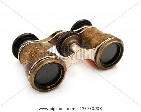 Antique brass binoculars isolated at white background