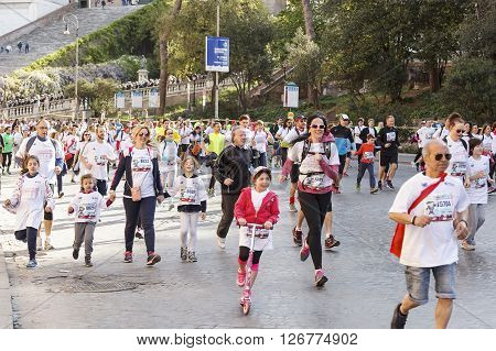 Rome Italy - April 10 2016: Participants in the Marathon city of Rome in 2016 while passing in front of the Capitol in the direction of the Theatre of Marcellus.