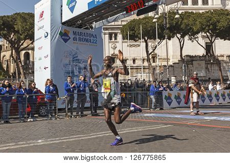 Rome, Italy - April 10, 2016: Amos Kipruto crosses the finish line in first place and won the men's race of Rome Marathon 2016.