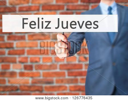 Feliz Jueves (happy Thursday In Spanish)  - Businessman Hand Holding Sign