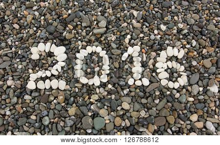 The Sign 2016 Made From White Pebbles
