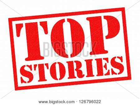 TOP STORIES red Rubber Stamp over a white background.