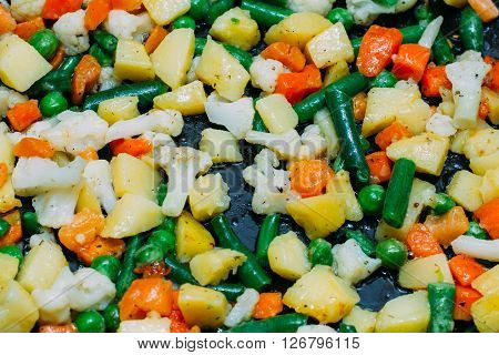frozen vegetable mix is fried on a griddle